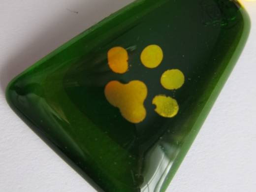 ohgw dog paw print on green cathedral triangle