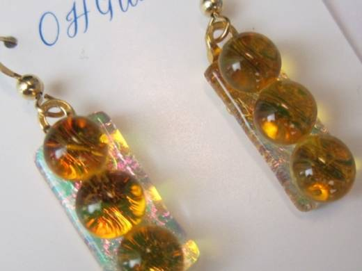 ohgw  pink dichroic on clear base with amber cabochons