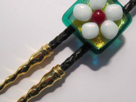 ohgw bolo tie with irridescent and dichroic floral motif